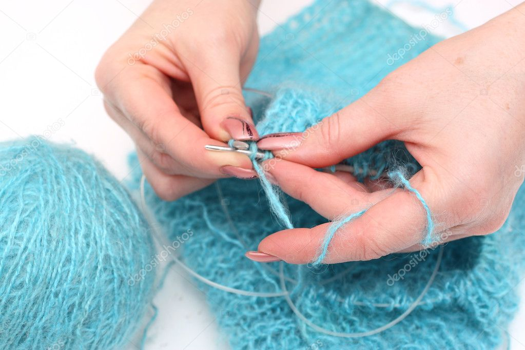 Woman hands knitting a turquoise pullover  Stock Photo #1955759