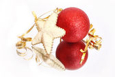 Curly christmas bauble and star — Stock Photo