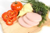 Sliced food arrangement with sausage — Stock Photo