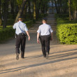 Municipal police patrol a park — Stock Photo