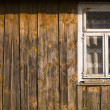 Wooden old cottage house wall and window — Stock Photo