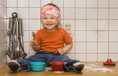Baby girl playing with sugar — Stock Photo