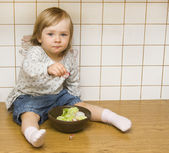 Baby girl in the kitchen — Stock Photo