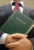 Lawyer holding criminal law book — Stockfoto