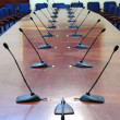 Royalty-Free Stock Photo: Microphones in the empty conference hall