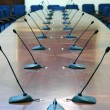 Microphones in empty conference hall — Stock Photo #1977866