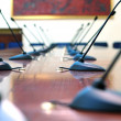 Microphones in the empty conference hall — Stock Photo