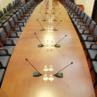 Stock Photo: Microphones in empty conference hall