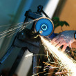 Royalty-Free Stock Photo: Angle grinder in use