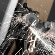 Stock Photo: Angle grinder in use
