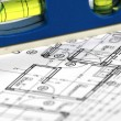 Spirit level and architectural plans — Stock Photo