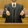 Portrait of a politician showing thumbs up — Stockfoto