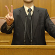 Portrait of a politician showing peace sign — Stockfoto