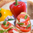 Bruschette with tomato, basil and cheese — Stock Photo