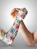 Economy arm wrestling — Stock Photo