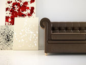 Leather couch and abstract canvas — Stockfoto