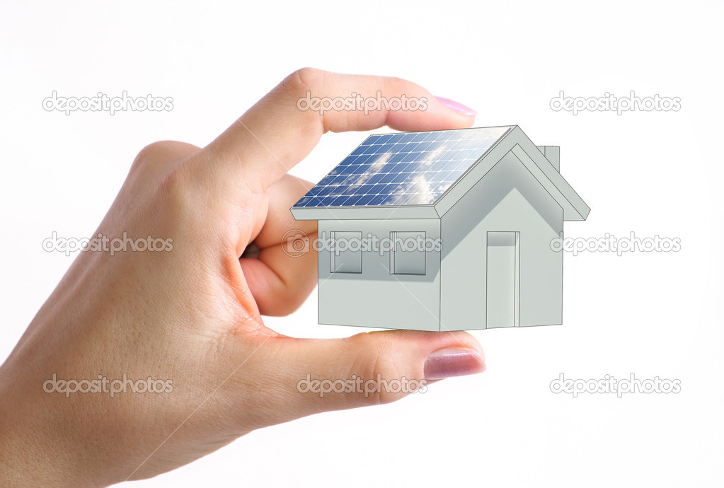 House with solar panel in the woman hand — Stock Photo #2526984