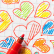 Colored hearts drawn on a sheet — Stock Photo