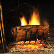Fire wood in a chimney - Stock Photo
