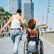 图库照片: Helping Wheelchair