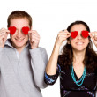Couple in love with red heart — Stock Photo