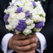 Stock Photo: Groom with wedding bouquet