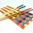Bamboo chopsticks on white - Stock Photo