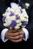 Groom with a wedding bouquet — Stock Photo