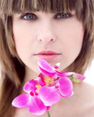 Portrait beautiful girl with orchid — Stock Photo