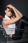 Woman in the shopping cart — Stock Photo