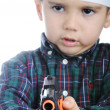 Boy pointing gun - Stock Photo