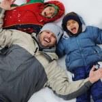 Happy family on winter vacation — Stock Photo