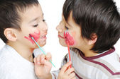 Cute little boy getting make-up on his — Stock Photo