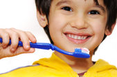 Little boy brushes her teeth — Stock Photo