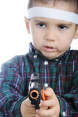 Boy pointing gun — Stock Photo