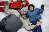 Happy family on winter vacation — Stock Photo