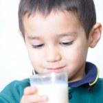 Child with milk — Stock Photo