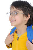 School boy holding a bag and going to school — Stock Photo