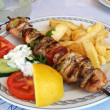 Greek meal pork souvlaki — Stock Photo