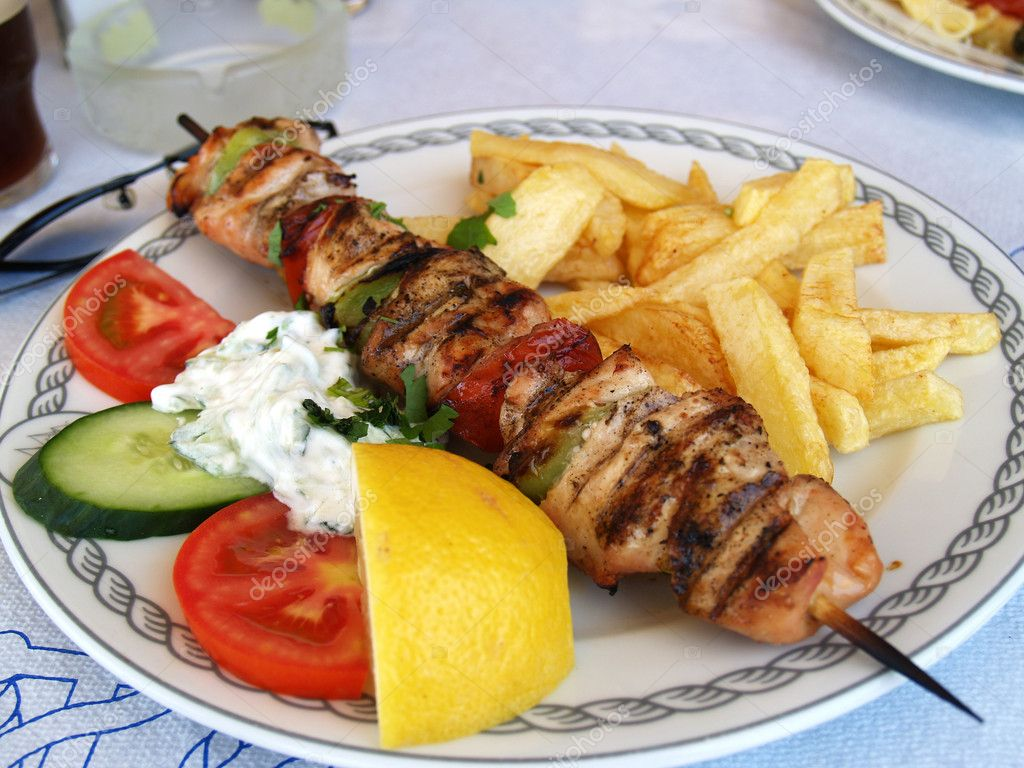 Plate with greek meal pork souvlaki in taverna  Stock Photo #1902165