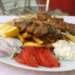 Greek meal pork souvlaki - Stock Photo