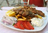 Greek meal pork souvlaki — Stock Photo