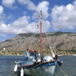Stock Photo: Boat in harbour of island Symi