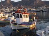 Fishing boat in greek harbour — Stock Photo