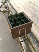 Box with bottles on the bicycle — Stock Photo