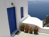 Blue door and window on Santorini island — Stock Photo