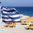 Stock Photo: Greek flag on beach