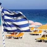 Greek flag on the beach — Stock Photo #2124723