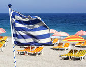Greek flag on the beach — Stock Photo