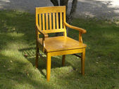 Old wood chair on the grass — Stock Photo